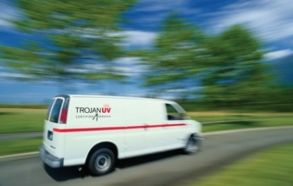 Trojan service van driving to perform on-site service on a TrojanUV system at a wastewater treatment plant