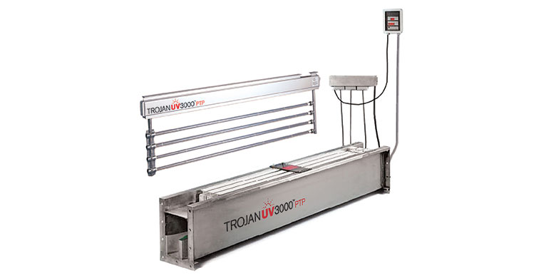 A photo of the TrojanUV3000PTP system with a module lifted out of a stainless-steel channel