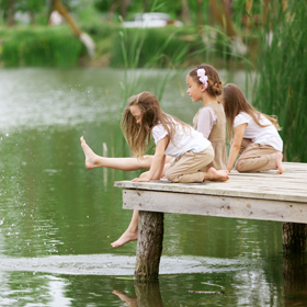 Kids playing by a lake