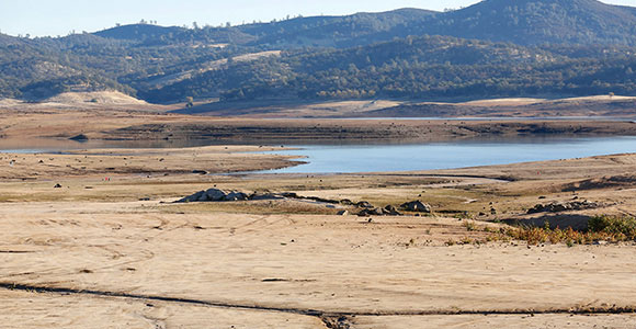 A photo of a dried up lake or river in an arid region of the world
