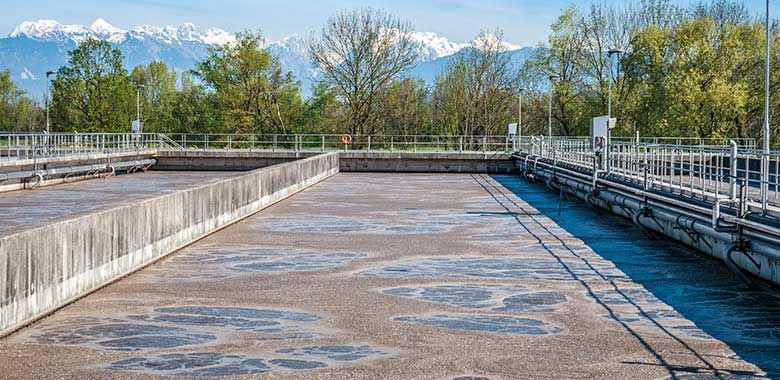 Low quality wastewater flowing through treatment process